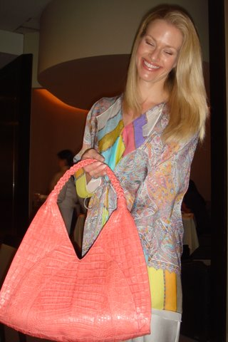 Blog 3 - model showing Nancy Gonzalez handbag