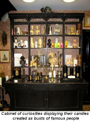 Blog 4 - Cabinet of curiosities displaying their famous candles created as busts of famous people