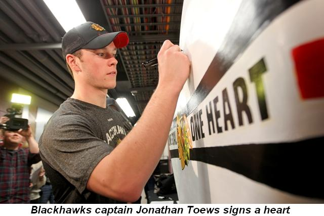 Blog 1 - Blackhawk's Captain Jonathan Toews signs a heart