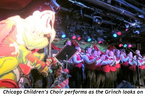 8 - Chicago Children's Choir performs as the Grinch looks on
