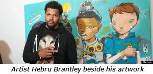 Artist Hebru Brantley beside his artwork