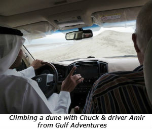 Climbing a dune with Chuck and driver Amir from Gulf Adventures