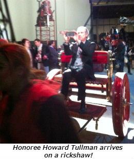 Honoree Howard Tullman arrives on a rickshaw