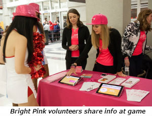 Bright Pink volunteers share info at game