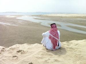 Lone arab on desert dune photo