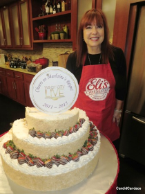 Maureen Schulman with her beautiful Eli's Cheesecake.