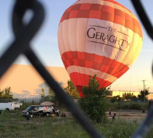 A hot air balloon lit the way to the party!