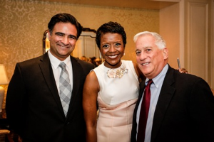 CHF executive director Phillip Bahar, Mellody Hobson and Walter Isaacson.