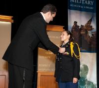 Pritzker Military Museum & Library pres/CEO Kenneth Clarke with JROTC student cadet Major Miranda Cardona