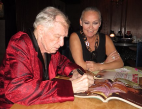 Hef signing my magazines at the Mansion