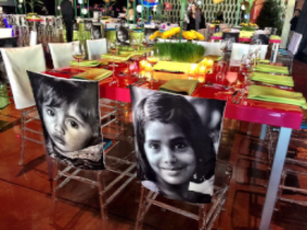 Chairs slip-covered with children's faces for UNICEF Hope Gala at the Geraghty