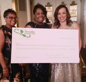 Check presentation to Metropolitan Family Services. (L to R) Mischelle Causey Drake (exec.dir. MFS), Audrena Spence and president Denise Gardner.