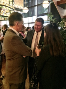 Cute co-owner David Flom chats with party guests