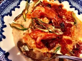 Shrimp and grits (white corn grits, tasso ham, tomato stew and crispy okra)