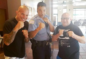 Chase Garrett, a cop for 3 decades, with friends before his retirement
