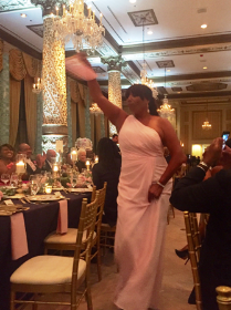 Bridesmaid Mellody Spann-Cooper is introduced at reception