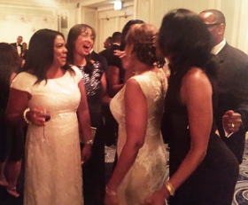 Angela Thompson (L) and friends congratulate the bride