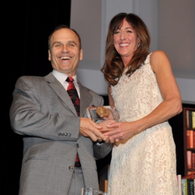 Scott Turow and Wendy Berger with award