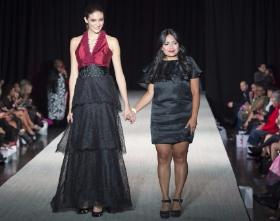 Designer Elda de la Rosa beside one of her designs