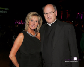 Bear Necessities founder Kathleen Casey and Father Paul White