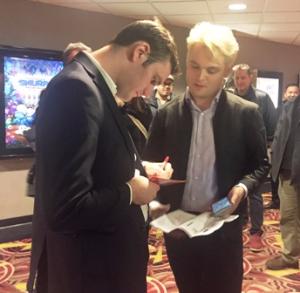 Cooper signs program for fan/friend Tanner Chap Branson