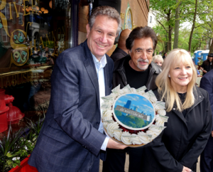 Joe Mantegna and wife Arlene celebrate with Marc Schulman and an Eli's Cheesecake!