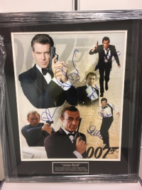 For silent auction, a poster signed by ALL the actors who played JAMES BOND!