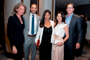 Ann Tomlinson, left, Robert and Joanna Sevim, Lisa Bailey and President of Related Midwest, Curt Bailey