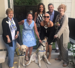 With Catherine Rupp (puppy trainer volunteer), Laurel Marks (CCI development director), Tracey Tarantino, Bruce Haas, and another volunteer with CCI dogs in training