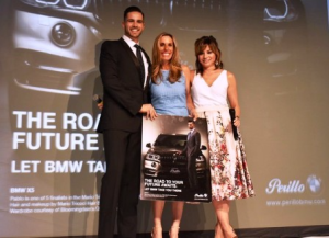 Trish Perillo and Susanna Homan announce winning ad with featured model on left