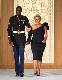 Laura Schwartz in finale with a Marine escort