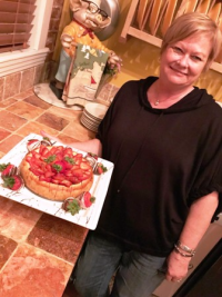 Master baker Toni York Marlen with her strawberry cheesecake specialty