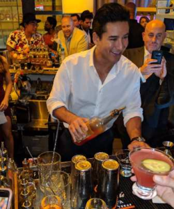 Mario Lopez mixes the event's signature cocktail, Pink-Titos, for the crowd