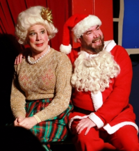 Mrs. Claus (Ed Jones) and Santa (Michael Hampton)