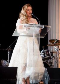 Michelle Durpetti (Gene & Georgetti, last year's recipient) presents Chicago Classic Award