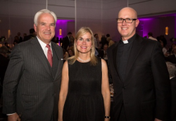 Jim and Kathy Hickey with Father Christopher Devron