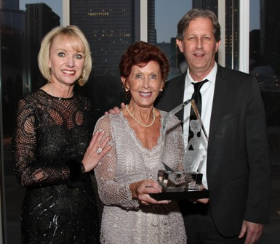 Lynelle Lynch (BCL pres) presents the Legacy Award to Lenie and Robert Passage honoring Leo Passage