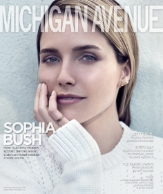 Chicago P.D.'s Sophia Bush signs her Michigan Avenue Mag cover with Dan Uslan