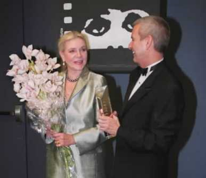 Kutz presenting a Lifetime Achievement Award to Lauren Bacall