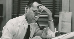 A young Art Paul at Playboy--did you have to smoke a pipe to get the job?