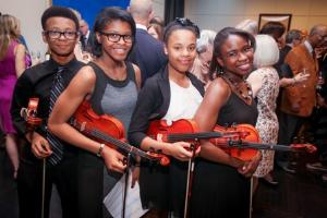 Jazz Alive violin students Rashaad Ali, Ivy Harris, Rayah Taylor, Sydney Davis