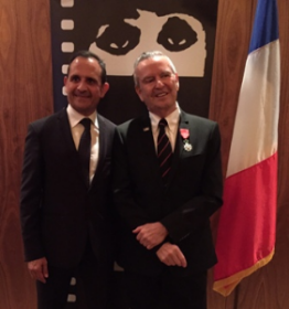 Michael is presented with his medal by Vincent Floreani, Consul General of France