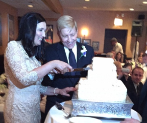 Nicki and Bob cut their cake