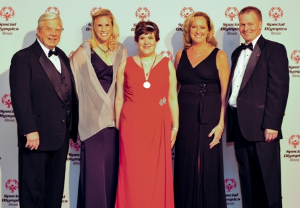 SOI Board Chair, Jim Corrigan; SOI Foundation Board Member, SOI Board Vice-Chair and Foundation Board member, Jenny Fortner; featured SOI athlete of the evening, Kelli Ewbank; Inspire Greatness Gala Chair and Pres/CEO of MAKE Corporation, Karen Wilson; SOI Pres/CEO, Dave Breen.