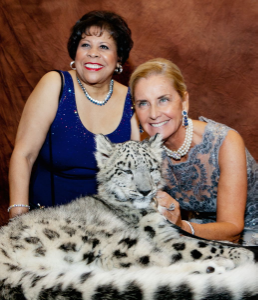 Event co-chair Vonita Reescer and Reute Butler with endangered snow leopard