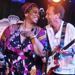 Our own Diva Lynne Jordan singing with her childhood idol, David Cassidy.
