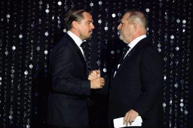 Leo greets Harvey at AmfAR Gala