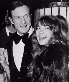 Hef with then girlfriend Barbie Benton, who found the Mansion for Hef to buy