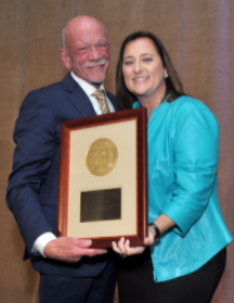 Laura Ricketts presents Art Johnston with the Jane Addams Making History Award for Distinction in Social Service