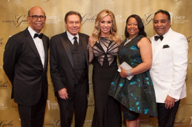 Michael L. Lomax, hosts Mike and Kristina McGrath, Tyronne Stoudemire (gala chair)